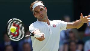 Switzerland's Roger Federer in action during the first round match against Serbia's Dusan Lajovic.(REUTERS)