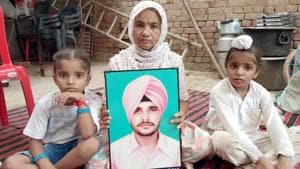 Gurbhej's mother and children at their home.(Sameer Sehgal/HT Photo)