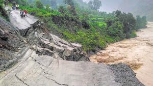 A road leading to Rasiyabad village washed away after heavy rain at Munsiyari in Pithoragarh district on July 2.(PTI)