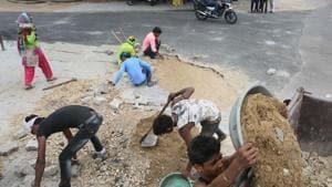 Potholes being mended in view of PM Narendra Modi's proposed public meeting at Jyoti Nagar in Jaipur.(Himanshu Vyas/HT PHOTO)