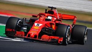 Ferrari's Sebastian Vettel drives during the second practice session at Silverstone motor racing circuit on Friday.(AFP)