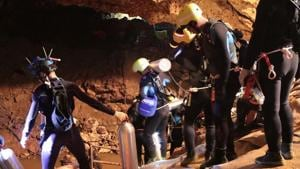 This undated handout photo taken recently and released by the Royal Thai Navy on July 7, 2018 shows a group of Thai Navy divers in Tham Long cave during rescue operations for the 12 boys and their football team coach trapped in the cave at Khun Nam Nang Non Forest Park in the Mae Sai district of Chiang Rai province.(AFP)