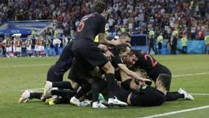 Get highlights of Russia vs Croatia, FIFA World Cup 2018 quarter-final match, here. Croatia's Ivan Rakitic celebrates with team mates after scoring the deciding penalty during the shootout against Russia.(REUTERS)