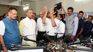CM Trivendra Singh Rawat takes a look at a drone at the centre at ITDA in Dehradun on Monday.(HT Photo)