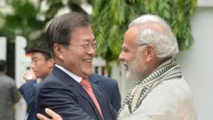 South Korean President Moon Jae-in is hugged by Prime Minister Narendra Modi during their visit to Gandhi Smriti in Delhi on July 9, 2018.(REUTERS)