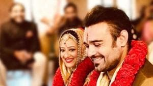 Mithun Chakraborty's son Mimoh with his bride Madalsa Sharma during their Ooty wedding on Tuesday.(Madalsasharma/Instagram)