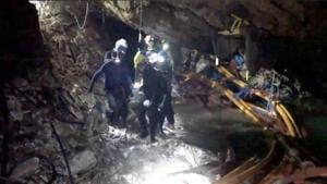 Rescue personnel work at the Tham Luang cave complex in the northern province of Chiang Rai, Thailand.(REUTERS)