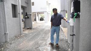 Amit Joshi, secretary, Saidatt Residency showing the rainwater harvesting system in Saidatt residency, Baner.(HT PHOTO)