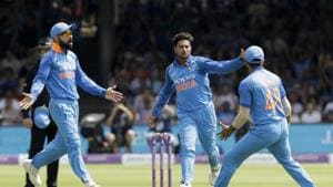 London: India's Kuldeep Yadav, center, celebrates taking the wicket of England's Jonny Bairstow with India captain Virat Kohli, left, during the one day cricket match between England and India at Lord's cricket ground in London.(AP)