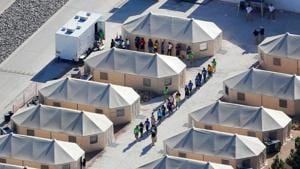 Immigrant children now housed in a tent encampment under the new 'zero tolerance' policy by the Trump administration are shown walking in single file at the facility near the Mexican border in Tornillo, Texas.(Reuters File)