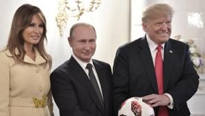US First Lady Melania Trump, Russian President Vladimir Putin, and US President Donald Trump, pose with a soccer ball after a press conference following their meeting at the Presidential Palace in Helsinki, Finland.(AP File Photo)