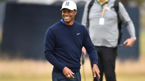 US golfer Tiger Woods smiles as he putts on the 9th green during a practice round at The 147th Open golf Championship at Carnoustie, Scotland.(AFP)