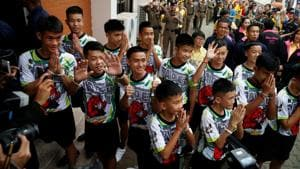 The 12 boys and their soccer coach who were rescued from a flooded cave arrive for a news conference in the northern province of Chiang Rai, Thailand.(REUTERS File Photo)