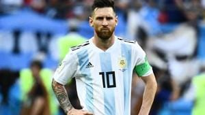 Carlos Tevez wants Lionel Messi to continue playing for Argentina despite the World Cup poor show.(AFP)