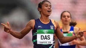 Hima Das celebrates after winning gold in the final of the women's 400m on day three of the IAAF World U20 Championships.(PTI)