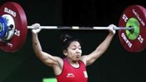 Mirabai Chanu lifted a personal best of 196kg (86kg snatch, 110kg jerk), a national record, to win the Commonwealth Games title.(AP)