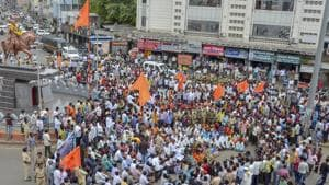Maratha community members block the road during a protest against the government demanding reservation, in Solapur.(PTI)