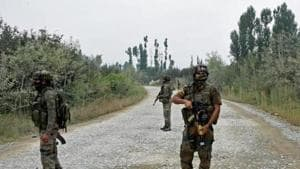 Army personnel stand guard during a gun battle with militants, who launched a pre-dawn attack on a district police complex in which three security personnel were martyred, in Pulwama of South Kashmir.(PTI File Photo)
