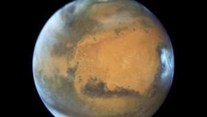 A study published Wednesday suggests a huge lake of salty water appears to be buried deep in Mars.(AP Photo)