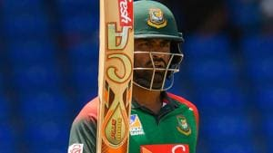 Tamim Iqbal of Bangladesh celebrates his century during the 3rd and final ODI match against West Indies.(AFP)