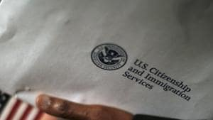 A man holds an envelope from the US Citizenship and Immigrations Service in Washington.(REUTERS)