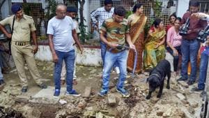 Police with their sniffer dogs investigate the site where a rape victim was allegedly buried, at a government shelter home in Muzaffarpur, on Monday, July 23, 2018.(PTI File Photo)