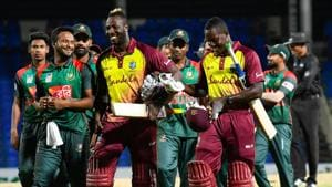 Shakib Al Hasan (L) of Bangladesh, Andre Russell (C) and Rovman Powell (R) of West Indies smile at the end of the 1st T20i match between West Indies and Bangladesh at Warner Park, Basseterre.(AFP)