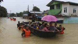 Members of Myanmar Rescue Team carry residents in a boat to travel along a flooded road in Bago, about 80 kilometers (50 miles) northeast of Yangon, Myanmar on July 29, 2018.(AP Photo)