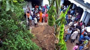 People surround as police investigate the site where a rape victim was allegedly buried, at a government shelter home in Muzaffarpures of the facility, and several were raped.(PTI Photo)