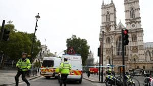Police officers stand at a cordon after a car crashed outside the Houses of Parliament in Westminster, London, Britain, on Tuesday.(Reuters photo)