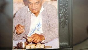 Atal Bihari Vajpayee savouring Kolkata's signature street snack phuchka at the Beriwala house. He also autographed the photo.(Samir Jana/HT PHOTO)