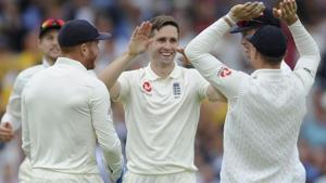 England's Chris Woakes celebrates with teammates after dismissing India's KL Rahul at Trent Bridge.(AP)