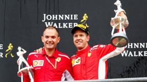 Formula One F1 - Belgian Grand Prix - Spa-Francorchamps, Stavelot, Belgium - August 26, 2018 Ferrari's Sebastian Vettel celebrates with a trophy on the podium after winning the race REUTERS/Francois Lenoir(REUTERS)