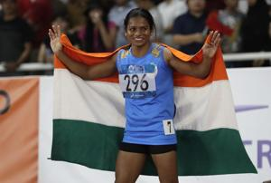 India's Dutee Chand celebrates after the women's 100m final at the 18th Asian Games in Jakarta, August 26(AP)