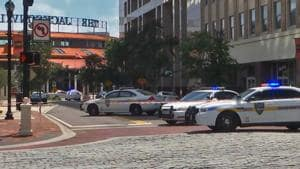 This handout image distributed courtesy of WJXT, a local Jacksonville television station, shows police cars blocking a street leading to the Jacksonville Landing area in downtown Jacksonville, Florida.(AFP Photo)