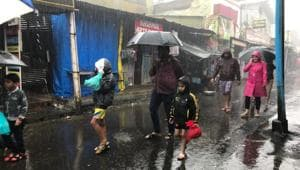 People holding umbrellas and wearing raincoats in Mahabaleshwar on August 16.(HT File Photo)