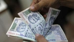 Activists and non-governmental organisations (NGOs) have criticised the state's decision to replace distribution of food grains to the underprivileged through public distribution system (PDS) with direct benefit transfer (DBT) of subsidy (in cash) into their accounts.(REUTERS)
