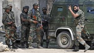 An army soldier showing victory sign after killing two militants in Hajin some 40 kilometres north of Srinagar,India.(HT File photo)