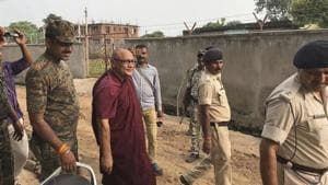 55-year-old monk Bhante Sangh Priya, a Bangladeshi national, is escorted by police after being arrested in Bodh Gaya, in Bhiar on Thursday.(AP Photo)