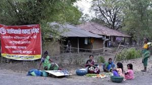 A banner in Hanuman Nagar village in Palghar Taluka opposing the Mumbai - Ahmedabad bullet train in May. People who cede their land for the bullet train project can get the stamp duty of any property they buy reimbursed, provided they do it within three years of handing over the land, a top official said.(Anshuman Poyrekar/HT Photo)