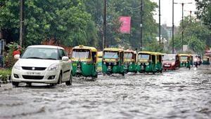 Vehicles wade through a waterlogged road near Turkman Gate in central Delhi.(Amal KS /HT Photo)