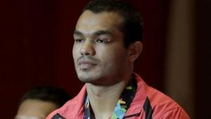 Men's middleweight boxing bronze medalist's India's Krishan Vikas stands on the podium at the 18th Asian Games in Jakarta, Indonesia, Saturday, Sept. 1, 2018.(AP)