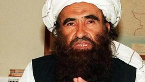 In this photograph taken on October 19, 2001, founder of the Haqqani network Maulvi Jalaluddin Haqqani, gestures as he speaks with a group of media representatives in Pakistan's city of Islamabad.(AFP)
