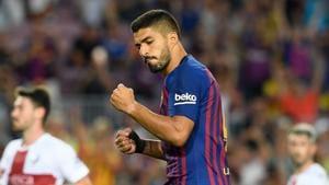 Barcelona's Uruguayan forward Luis Suarez celebrates after scoring during the Spanish league football match between FC Barcelona and SD Huesca at the Camp Nou.(AFP)