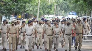 Police holding a flag march on the eve of student elections at Panjab University.(HT Photo)