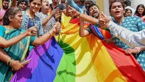 LGBTQ community people, with a rainbow flag, celebrate the Supreme Court verdict which decriminalises consensual gay sex, in Bengaluru.(PTI Photo)