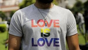 A gay rights activist outside the Supreme Court before the judgement on Section 377 of the Indian Penal Code, that criminalizes homosexuality, is delivered, in New Delhi on September 6, 2018.(AP)
