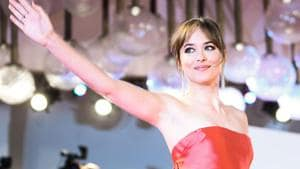 Actress Dakota Johnson waves as she arrives for the premiere of the film Suspiria presented in competition on September 1, 2018 during the 75th Venice Film Festival.(AFP)