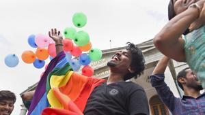 LGBT community supporters celebrate after the Supreme Court verdict which decriminalises consensual gay sex, in Bengaluru.(PTI Photo)