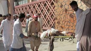 Afghan men carry an injured man to a hospital after a suicide attack in Nangarhar province, Afghanistan September 11, 2018.(REUTERS)